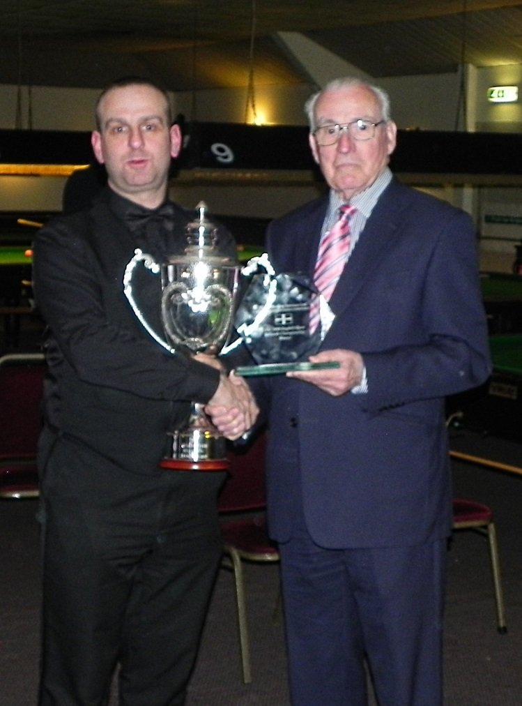 Ron Agnew presenting the cup to Dave Causier